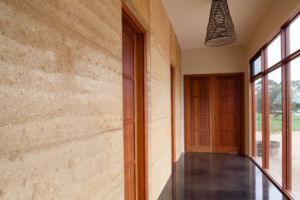 The Home Features A Rammed Earth Wall Exposed To The North Winter Sun That,  In Tandem With The Polished Concrete Floor, Provides Extensive Thermal Mass  And ...
